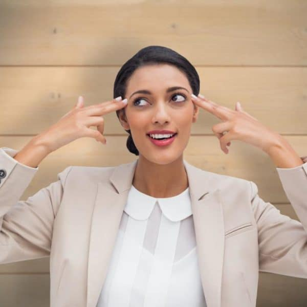woman pointing at her own head thinking